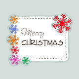 Merry Christmas celebration with stylish text and snowflake. Royalty Free Stock Image
