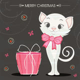 Merry Christmas celebrations with cute cat in bow . Merry Christmas celebrations with cute cat in bow and pink gift box on stylish background Stock Photo