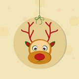 Merry Christmas celebrations with hanging frame of reindeer. Hanging rounded frame with reindeer face on stylish background for Christmas and other occasion Royalty Free Stock Image