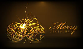 Merry Christmas celebrations with Xmas ball. Beautiful shiny Xmas ball in golden color on brown background for Merry Christmas celebrations Royalty Free Stock Image