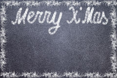 Merry Christmas on the chalk board Royalty Free Stock Photos