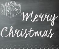 Merry Christmas chalkboard. Merry Christmas text on a black chalkboard Royalty Free Stock Photo