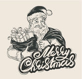 Merry Christmas. Cheerful Santa Claus holding a Stock Images
