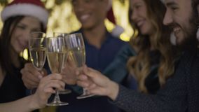Merry Christmas! Cheers! champagne glasses closeup. 4K. Merry Christmas! Cheers! champagne glasses closeup stock footage