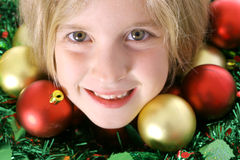 Merry Christmas child. Shot of a little girl with ornaments -Merry Christmas child Stock Image