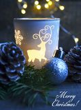 Merry Christmas.Christmas decoration on old wooden background.Winter holidays concept. Merry Christmas.Christmas decoration with candle light on old wooden Royalty Free Stock Photography