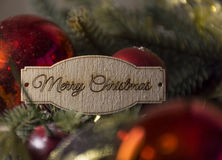 Merry Christmas, Christmas tree decorations. Merry Christmas, gold Christmas, red balls decoration, green spruce branches, Christmas tree, holiday royalty free stock image