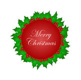 Merry Christmas in circle with Christmas holy leaves Stock Photo
