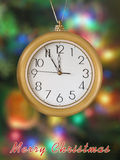 Merry Christmas! Clock (5 minutes to 12). Xmas tree on background Royalty Free Stock Images