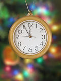 Merry Christmas! Clock (5 minutes to 12). Xmas tree on background Stock Images