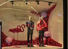 Merry Christmas clothing shop window,Winter fashion boutique display window with mannequins Stock Images