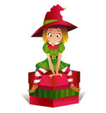 Merry christmas colorful card design, vector illustration. Merry christmas colorful card design, Santa Claus elf helper sitting on the gift box. happy new year Royalty Free Stock Photo