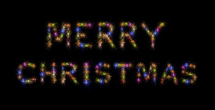 Merry Christmas Colorful Fireworks. Merry Christmas written with Sparkle fireworks over black sky/background Royalty Free Stock Photography
