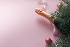 Merry Christmas and Happy New Year. Pink background. Merry Christmas concept. Bottle champange with fir brunches and christmas balls and pink ribbon on pink vector illustration
