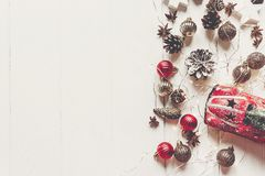 Merry christmas concept, flat lay. modern ornaments, car toy wit. H tree,  anise cones and lights on rustic white wood top view, space for text. seasonal Stock Photography
