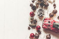 Merry christmas concept, flat lay. modern ornaments, car toy wit. H tree, anise cones and lights on rustic white wood top view, space for text. seasonal stock images