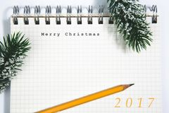 Merry Christmas concept, Notebook and yellow pencil Stock Photography