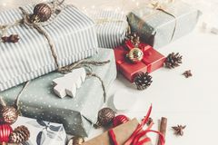 Merry christmas concept. present boxes with ornaments tree cones. Anise and lights on the rustic white wooden background, space for text. seasonal greetings royalty free stock photography