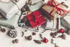Merry christmas concept. presents with ornaments pine cones anis. E and lights on rustic white wooden background top view, space for text. seasonal greetings Stock Images