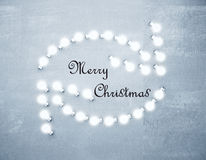 Merry Christmas concept with rotating glowng arrows at concrete Royalty Free Stock Photography