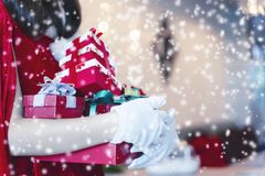 Merry Christmas concept. Santa holding gift boxes with falling s stock images