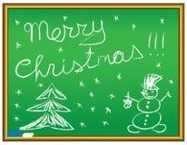 Merry christmas congratulation. On a chalkboard Royalty Free Stock Photos