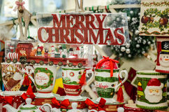 Merry Christmas craftsmanship. Merry Christmas cups and toys on a beautiful display Royalty Free Stock Photography