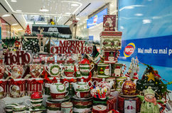 Merry Christmas craftsmanship. Merry Christmas cups and toys on a beautiful display, in a the Mega Mall shopping mall, Bucharest, Romania, with Pepco store in Royalty Free Stock Photos