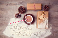 Merry Christmas creative still life with gift boxes and cup of chocolate. View from above royalty free stock photo