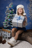 Merry Christmas - cute girl with Christmas gift Stock Photography
