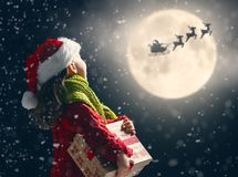 Girl with present at Christmas stock photo