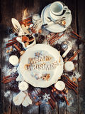 Merry Christmas Decor on Wooden Table. Baked Letters. Top view Royalty Free Stock Photo