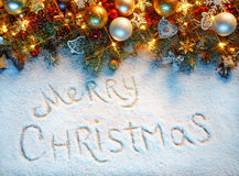 Merry Christmas!! Decorated fir tree on snow Royalty Free Stock Images