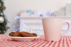 Merry Christmas. Decorated room no people cup of milk and cookies on table close-up royalty free stock photos