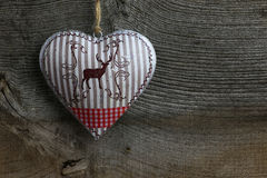 Merry Christmas Decoration Deer in Tin Heart Stock Photos