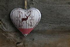 Merry Christmas Decoration Deer in Tin Heart Stock Photos