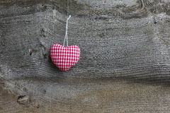 Merry Christmas Decoration Gingham Fabric Heart. Christmas handmade decoration gingham fabric hearth over rustic Elm wood background - retro style design, copy Stock Images