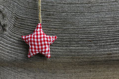 Merry Christmas Decoration Gingham Fabric Star. Christmas handmade decoration gingham fabric star over rustic Elm wood background - retro style design, copy Royalty Free Stock Photography