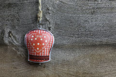 Merry Christmas Decoration Gingham Heart Pattern Tin Bell. Christmas handmade decoration gingham heart pattern on tin bell over rustic Elm wood background Royalty Free Stock Photo