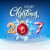 Merry Christmas 2017 decoration poster card. Happy New Year sign background and composition on a snowy field with Christmas toys and rooster, garlands, candy Stock Photos