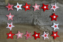 Merry Christmas  Decoration Red and White Fabric Stars On Rustic Royalty Free Stock Photography