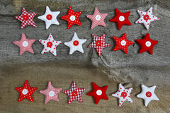Merry Christmas  Decoration Red and White Fabric Stars On Rustic. Christmas decoration red, white, gingham, stripes fabric stars with buttons  on rustic Elm wood Royalty Free Stock Image