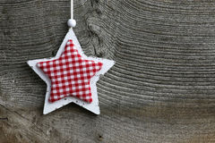 Merry Christmas Decoration White Wooden Star Gingham Fabric Patt. Christmas handmade decoration Shabby Chic wooden star with gingham fabric pattern over rustic Stock Photos