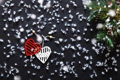 Merry Christmas decorations, snowflakes, white red hearts and green xmas tree on black wooden background card, top view Royalty Free Stock Photography