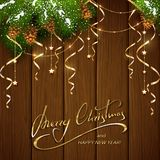 Merry Christmas with decorations and streamers on brown wooden   Royalty Free Stock Photo