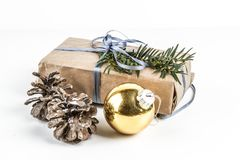 RUSTIC HOMEMADE PRESENT BOX. CHRISTMAS ORNAMENTS ON WHITE BACKGROUND. MERRY CHRISTMAS. DECORATIVE ELEMENTS OVERHEAD PHOTO. BEAUTYFUL ORNAMENT TOOLS STILL LIFE royalty free stock photography