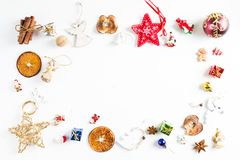 CHRISTMAS ORNAMENTS IN FRAME. DECORATIVE ELEMENTS ON WHITE BACKGROUND. MERRY CHRISTMAS. DECORATIVE ELEMENTS PHOTO.nBEAUTYFUL ORNAMENT TOOLS STILL LIFE. ISOLATED royalty free stock photography