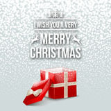 Merry Christmas Design Typography Lettering Greeting Card with Falling Snowflakes and Xmas Tree Background with Gift Box Royalty Free Stock Image