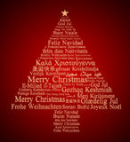 Merry Christmas in different languages. Forming a Christmas tree Royalty Free Stock Photos