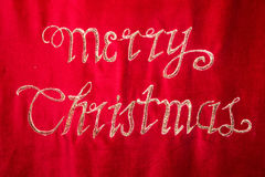 Merry christmas embroidery on red fabric Stock Image